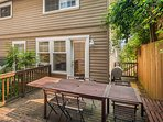 The outdoor patio has a barbecue, and a table with seating for 8