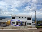 You are inquiring about the lower left unit, circled in this photo.