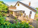 Your private back garden of Badgers Den Cottage has sun loungers, dining table and BBQ area.