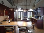 Fully-equipped kitchen with dishwasher, stainless-steel refrigerator, cooktop