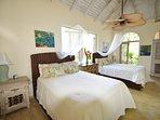 Spacious 3rd bedroom with double queen beds, fans and en-suite bathroom