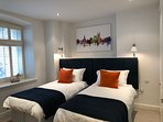 Main bedroom can be configured as twin beds or super king