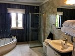 Family bathroom with corner bath and walk in shower. There is also an ensuite bathroom.