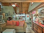 Vaulted wood ceilings highlight the main living space.