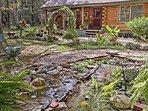 A beautiful pond adorns the yard.