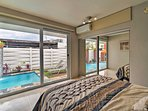 This bedroom also boasts a pool view and patio access.