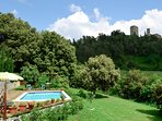 From the lawn surrounding the private pool you can see the bell tower of Montecastelli