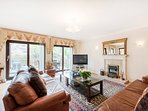Thames river views from  lounge, sliding doors to the decking are. Free Wifi , flat screen TV