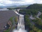 Walk across the awe inspiring Hinze Dam, 22 minutes by car
