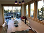 Dining area overlooking the outdoor patio off the kitchen