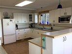 Efficient kitchen with gas stove, dual ovens and plenty of room to move around