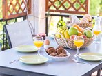Plentiful breakfasts on the veranda with views to the pool and the olive orchard!