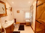 First floor Rose en suite shower room with oak and Grohe fittings,heated towel rail and large shower