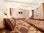 Lavender Suite has romantic African nets and luxury Bedeck bedding