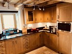 The Barn kitchen with a large Range Master, integrated appliances and a well equipped kitchen