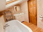 The Barn bathroom with huge Sottini bath. Watch the stars while you bathe!