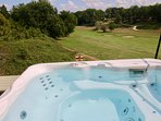 Enjoy a glass of wine in the Jacuzzi whilst watching the golfers