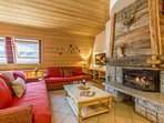 Comfortable living room with cosy fireplace & sofa bed for 2