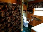 Full bathroom on the main level with handicap handles by the toilet and tub.  Wheelchair accessible.