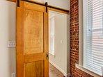 Original Wood Door that has been refurbished - and original door hardware!   Sliding Door to Master Suite