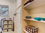Laundry Area with additional clothes hanging area;   Linen Storage & toiletries  Cleaning Mop, Broom and Ironing Board...