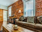Exposed Brick Accent Wall in the Living Space - also has accent lighting that automatically turns on in the evenings.