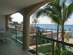 Terrace view, you have direct access to the beach and pool areas with steps off the terrace.