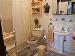 En-Suite Master Bathroom With Large Shower, Sink,Toilet, Mirror Cabinet, Shelves