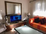 Large living room (sitting room) seating 10 persons with a 42 inch LED TV and fast unlimited Wi-Fi.