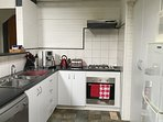 Fully equipped kitchen with coffee machine.