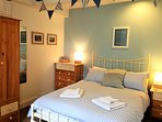 Double bedroom: wrought iron bed, comfortable mattress and ample storage