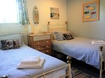 Twin bedroom: wrought iron beds (full size singles), deep, comfy  mattresses, wardrobe and drawers