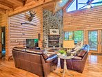 Cozy up by the stone fireplace while admiring the spectacular views outside.