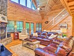 With wood paneling and cathedral ceilings, this home is a lakefront dream.