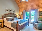 Relax on this king bed which leads right out to the deck.