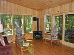 The living area with gas-fired wood stove.