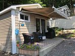 Cottage with comfortable seating on your private patio to sip a drink as you gaze at the Lake!