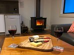 Relax with a glass of wine by the wood burning fireplace.