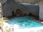 Heated pool with integrated jacuzzi, set into a cave!