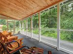 Sit back and relax in the fully screened in porch.