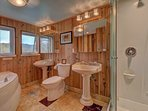 Downstairs full bath with radiant heated marble floors, cedar walls, double sinks, jacuzzi  tub....