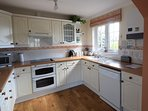 Kitchen with dishwasher, microwave, fridge freezer, electric oven
