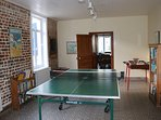 Games room with table football and lots of books - view through to dining room.