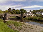 The ancient 3 arch bridge over the River Elwy in to Llanfair Talhaiarn.