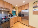 Amenities include gas range and coffee maker.