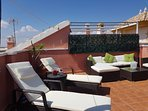 Large roof terrace with rattan sun loungers, sofa and chairs. Relax with a glass of sangria!