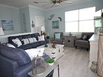 The beach themed living room in unit E provides a great setting to relax.