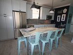 The custom island and kitchen amenities.