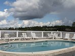 Our community pool overlooking the lake is the perfect spot to chill .