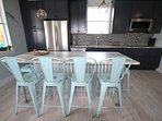 Custom built industrial themed island and comfy stools.